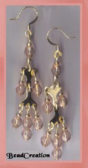 gold chandelier earrings pink glass