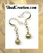 Fresh water gold pearls with 22k gold